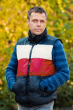 Portrait of oung man in autumn park Stock Photography