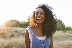 Portrait outdoors of a young afro american woman . Yellow backgro Stock Images