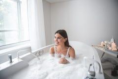 Optimistic girl having leisure in cozy bath royalty free stock photos
