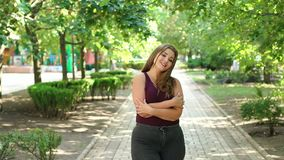 Portrait of an overweight girl in Park in summer. Portrait of a cute teenage girl with excess weight in the city Park in the summer. Plus size model. Girl XXL stock footage