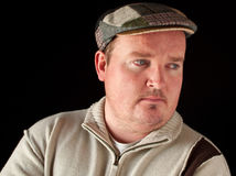 Portrait of a overweight male on black Royalty Free Stock Photos