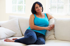 Portrait Of Overweight Woman Sitting On Sofa Stock Image