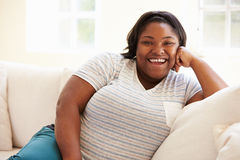 Portrait Of Overweight Woman Sitting On Sofa Royalty Free Stock Photos