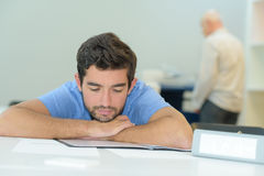 Portrait overworked businessman sleeping in office Royalty Free Stock Photo