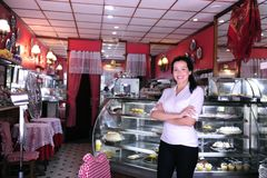 Portrait of the owner of a cafe. Portrait of the proud and confident owner of a small pastry store/ cafe/ small business stock photography