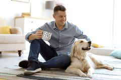 Portrait of owner with his friendly dog. At home royalty free stock images