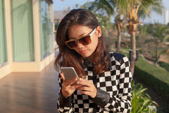 Portrait oy young woman reading message on mobile phone use for Stock Photography