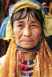 Portrait of Padaung long neck woman in traditional clothing Royalty Free Stock Images