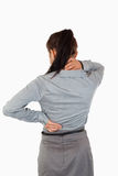 Portrait of the painful back of a businesswoman Stock Photo