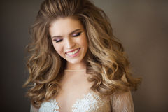 Portrait of a painted girl. Portrait of a young beautiful painted girl with a smile on her face with a magnificent hairdo Stock Image
