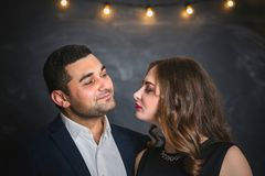 Portrait of a pair of brunettes male and female. Portrait of a passionate couple of brunettes male and female Stock Image