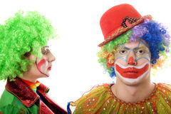 Portrait of a pair of serious clowns. Isolated Stock Photo