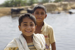 Portrait of 2 pakistani boys. Playing by the river in Lahore outskirts Royalty Free Stock Photo