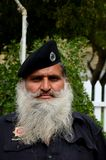 Portrait of Pakistani security guard with flowing white beard. Karachi, Pakistan - February 22, 2015: A Pakistani man in his security guard uniform salwar kameez Stock Images