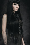 Portrait of a pale gothic woman. In black stock photo