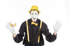 Portrait of a pantomime in the form of a criminal, ganster. Race Royalty Free Stock Photo
