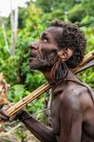 Portrait of papuan man with bow and arrows from Korowai Kolufo tribe Royalty Free Stock Image