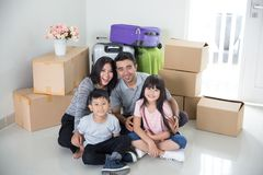 Parent and kids with cardboard box. moving to new house. Portrait of parent and kids with cardboard box. moving to new house concept Royalty Free Stock Images