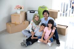 Parent and kids with cardboard box. moving to new house. Portrait of parent and kids with cardboard box. moving to new house concept Stock Images