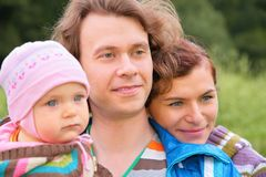 Portrait of parents with baby Royalty Free Stock Photography