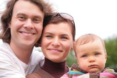 Portrait of parents with baby on nature royalty free stock photography