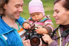 Portrait of parents with baby with photocamera Stock Images