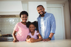 Portrait of parents and daughter in kitchen Royalty Free Stock Photos