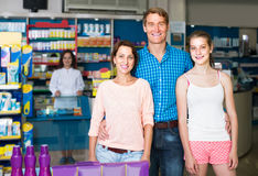 Portrait of parents with daughter teenager shopping in drug stor Stock Photography