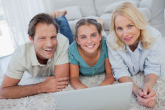 Portrait of parents and daughter using a laptop Royalty Free Stock Photo
