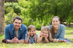 Portrait of parents and kids lying at park Stock Photo