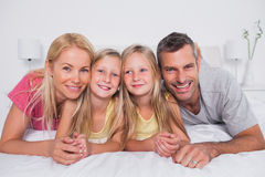 Portrait of parents lying in bed with their children Royalty Free Stock Photography