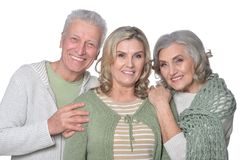 Parents with mature daughter. Portrait of parents with mature daughter isolated on white background royalty free stock photo
