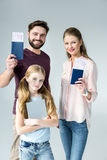 Portrait of parents with passports and tickets and daughter with tablet Royalty Free Stock Image