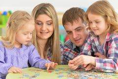 Parents playing with daughters. Portrait of parents playing with adorable little daughters Stock Images