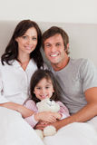 Portrait of parents posing with their daughter Royalty Free Stock Photos