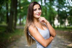 Portrait in park of a beautiful tanned teen student girl. Outdoors portrait in park of a beautiful tanned teen student girl Stock Photography