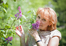 Portrait in a park with lilac Royalty Free Stock Image