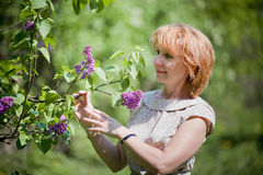Portrait in a park with lilac Royalty Free Stock Images