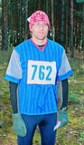 Portrait of the participant of sport orienteering. Portrait of the participant of orienteering  in forest during the autumn period Royalty Free Stock Images