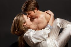 Portrait of a passionate couple. Over grey background stock image