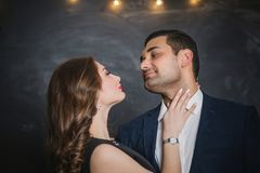 Portrait of a pair of brunettes male and female. Portrait of a passionate couple of brunettes male and female Royalty Free Stock Images