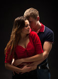 Portrait of a passionate couple. Over grey background Royalty Free Stock Photography
