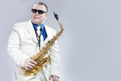 Portrait of Passionate Expressive Male Alto Saxophone Player in. White Suit. Posing Against White Background. Horizontal Image Composition Stock Photos