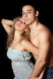 Portrait of passionate young couple. Isolated. On black stock image