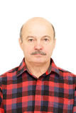 Portrait for passport. Elderly old man  with mustache, bald man in plaid shirt Royalty Free Stock Images