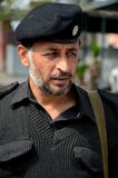 Portrait of Pathan police officer in grey sweater and police hat Peshawar Pakistan Royalty Free Stock Photography
