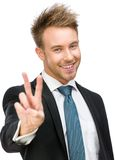Portrait of peace gesturing businessman Stock Photography