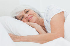 Portrait of a peaceful woman in bed Stock Photography