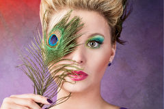 Portrait with a peacock feather Royalty Free Stock Photos
