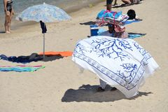 Portrait of a peddler african man selling beach towels stock photography